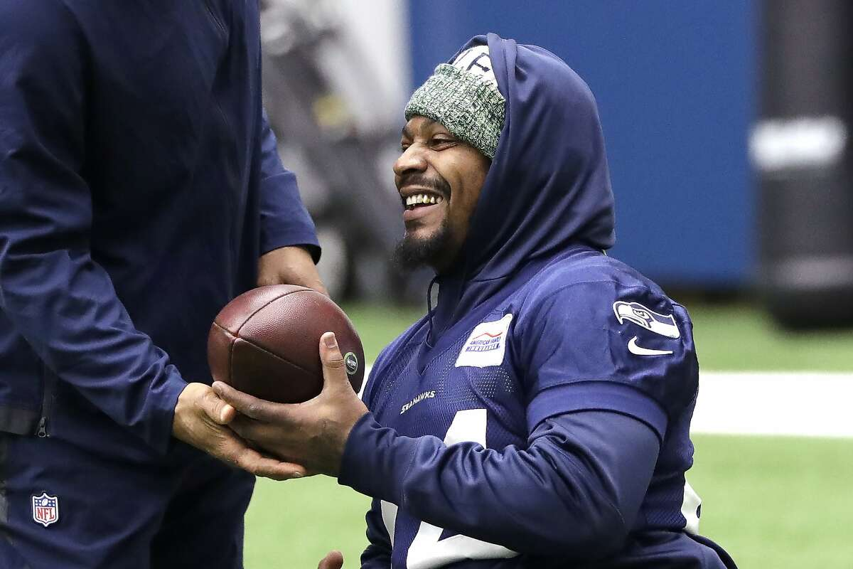 Seattle Seahawks running back Marshawn Lynch smiles during warmups at the NFL football team's practice facility Tuesday, Dec. 24, 2019, in Renton, Wash. When Lynch played his last game for the Seahawks in 2016, the idea of him ever wearing a Seahawks uniform again seemed preposterous. Yet, here are the Seahawks getting ready to have Lynch potentially play a major role Sunday against San Francisco with the NFC West title on the line.