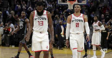 James Harden (13) and Russell Westbrook (0) walk off the court at the end of the game after the Golden State Warriors defeated the Houston Rockets 116-104 at Chase Center in San Francisco, Calif., on Wednesday, December 25, 2019. in the first half as the Golden State Warriors played the Houston Rockets at Chase Center in San Francisco, Calif., on Wednesday, December 25, 2019.