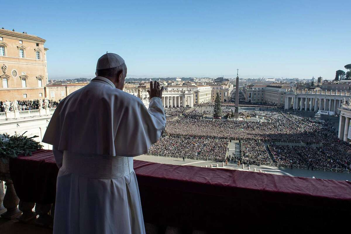 TOPSHOT - Pope Francis waves from the balcony of St Peter's basilica during the traditional