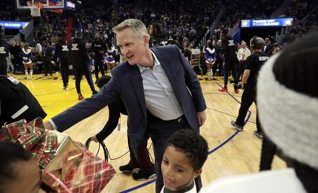 Warriors head coach Steve Kerr greets kids with the Season of Giving campaign that recieved gifts from players before the Golden State Warriors played the Houston Rockets at Chase Center in San Francisco, Calif., on Wednesday, December 25, 2019.