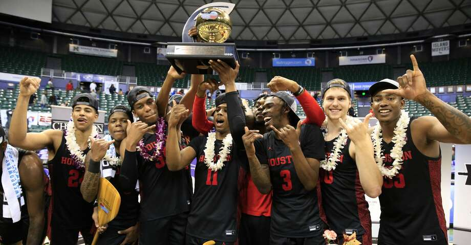 Houston players hoist the Diamond Head Classic trophy after defeating Washington 75-71 in an NCAA college basketball game Wednesday, Dec. 25, 2019, in Honolulu. (AP Photo/Marco Garcia) Photo: Marco Garcia/Associated Press