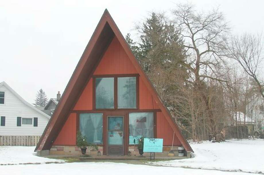 The A-frame building in Kaleva was home to beauty salons for more than 50 years. Now it is the home of A Touch of Health, a massage therapy business owned by Myra Lautner. (Michelle Graves/News Advocate)