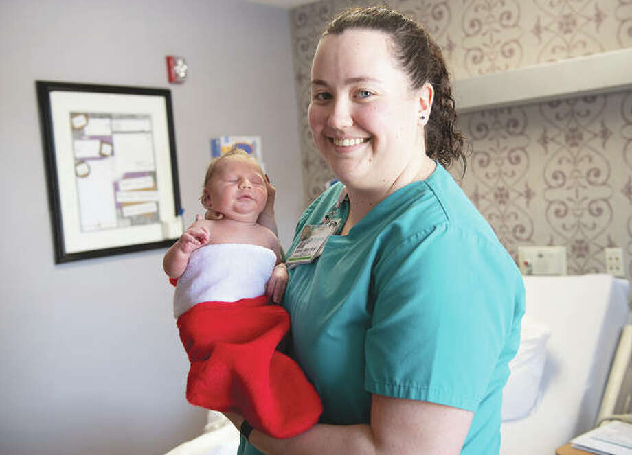 Passavant Area Hospital certified nursing assistant Kara Shafer holds baby Joseph Linhart, who is decked out in a Christmas stocking. Newborns in the hospital's family maternity suites went home in the stockings this month to celebrate their seasonal arrival. Photo: Kara Slating   Memorial Health System