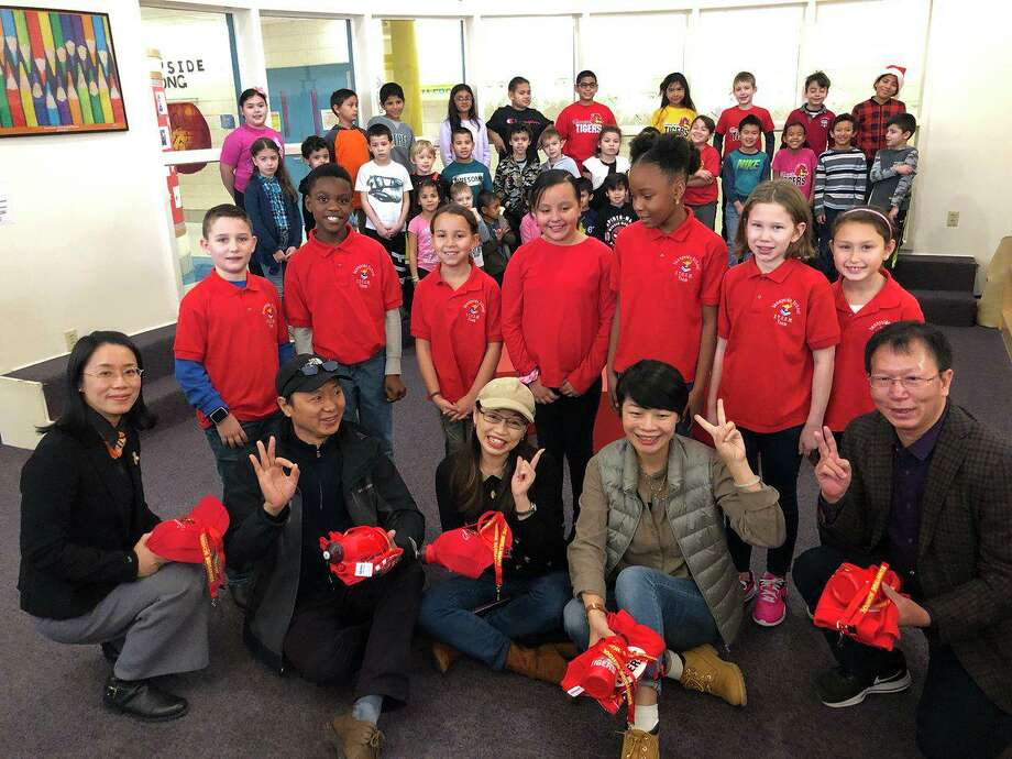 China's Guangdong Province educational delegates visited Sunnyside School on Dec. 13. The delegates visited classrooms and received information on professional development during their visit to Sunnyside School. Photo: Contributed Photo / / Connecticut Post