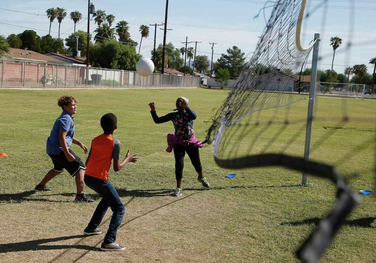 Refugee members of the volleyball team practice at Valencia Newcomer School in Phoenix in October 2019. The school is among a handful of public schools in the country dedicated exclusively to helping some of the thousands of children who arrive in the country annually. Arizona Gov. Doug Ducey told President Donald Trump's administration in December that his state will continue its tradition of welcoming refugees, one of about a dozen Republican governors so far to agree to their resettlement.