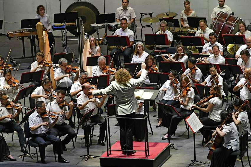 Stephane Deneve conducts the Philadelphia Orchestra on opening night at Saratoga Performing Arts Center on Wednesday, July 31, 2019 in Troy, N.Y. (Lori Van Buren/Times Union)