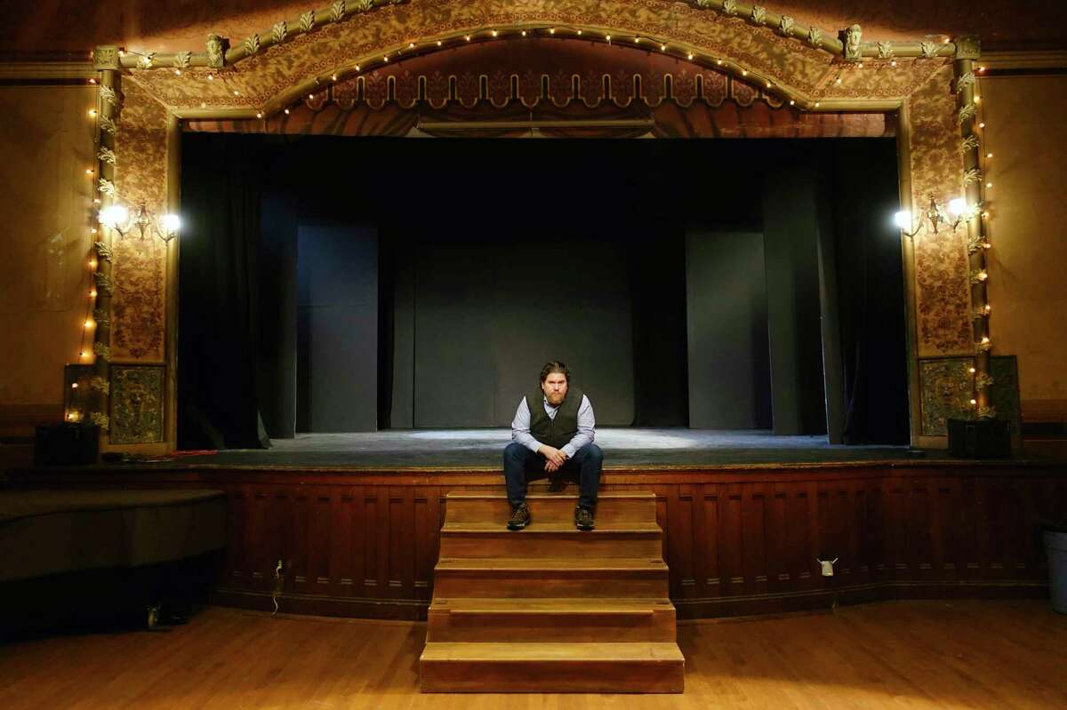 David Snider, the artistic director, of Hubbard Hall, sits on the stage inside the hall on Monday, Dec. 16, 2019, in Cambridge, N.Y. (Paul Buckowski/Times Union)