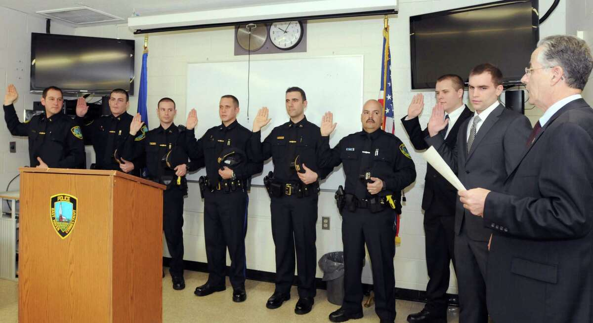 East Haven Mayor Joseph Maturo, Jr., far right, administers the Oath of Office during a swearing in ceremony for promoted officers and new officersThursday March 28, 2013 at East Haven Police Headquarters. From left to right: Lieutenant David Emerman, Sergeant Patrick Tracy, Sergeant Stephen Paulson, Sergeant Justin Brochu, Sergeant Anthony Rybaruk, Officer Eduardo Diaz, Officer Sean Moriarty, and Officer Mark Fitzgerald. Photo by Peter Hvizdak / New Haven Register