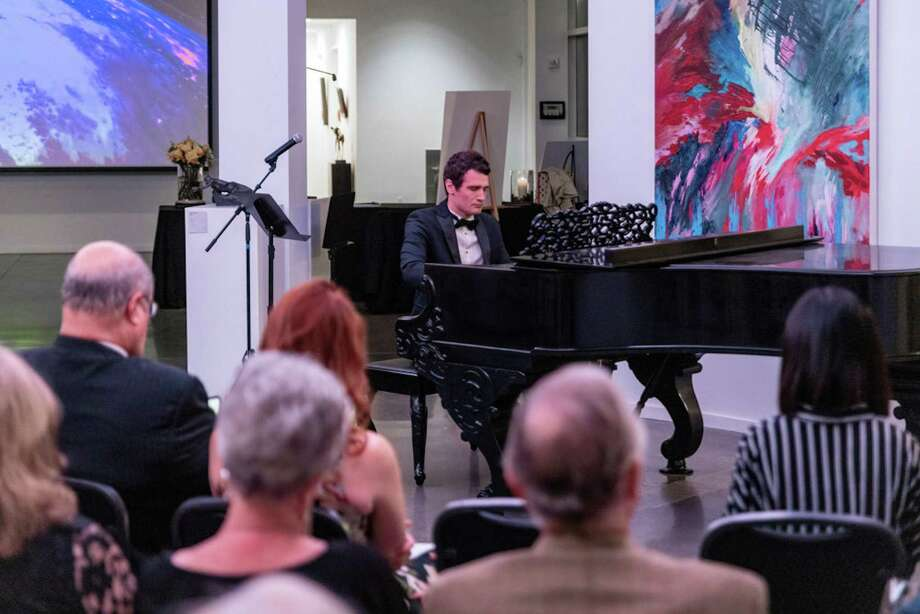 YTA's 2019 Grand Prize winner, pianist Artem Kuznetsov, performs during YTA's 2019-20 kickoff party at Glade Gallery in The Woodlands. Kuznetsov has been invited to perform with the Texas Medical Center Orchestra in 2020. The orchestra will extend a similar invitation to YTA's 2020 Grand Prize winner. Photo: Photo Courtesy The Young Texas Artists Music Competition