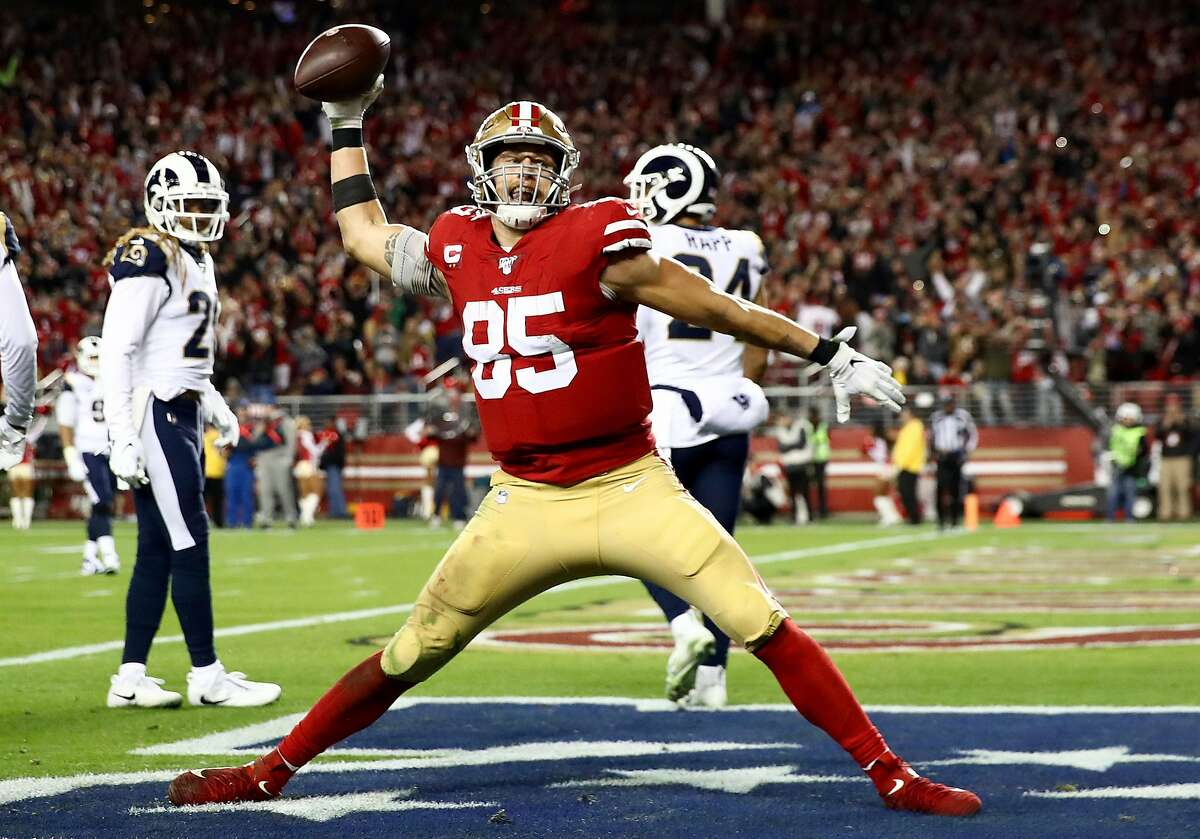 Tight end George Kittle of the San Francisco 49ers spikes the ball after his fourth quarter touchdown over the Los Angeles Rams at Levi's Stadium on December 21, 2019. According to reports, Kittle is currently negotiating a contract extension with the 49ers. (Photo by Ezra Shaw/Getty Images)