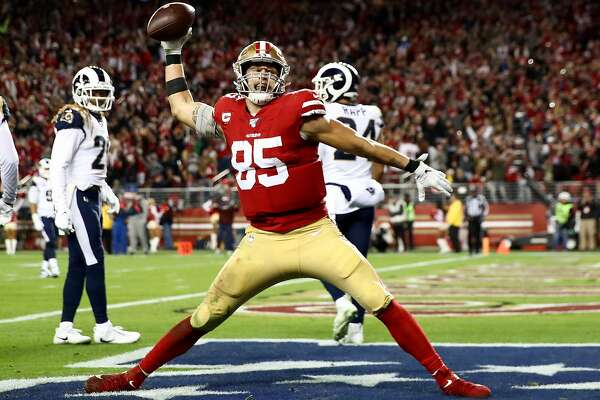 SANTA CLARA, CALIFORNIA - DECEMBER 21: Tight end George Kittle #85 of the San Francisco 49ers spikes the ball after his fourth quarter touchdown over the Los Angeles Rams at Levi's Stadium on December 21, 2019 in Santa Clara, California. (Photo by Ezra Shaw/Getty Images)