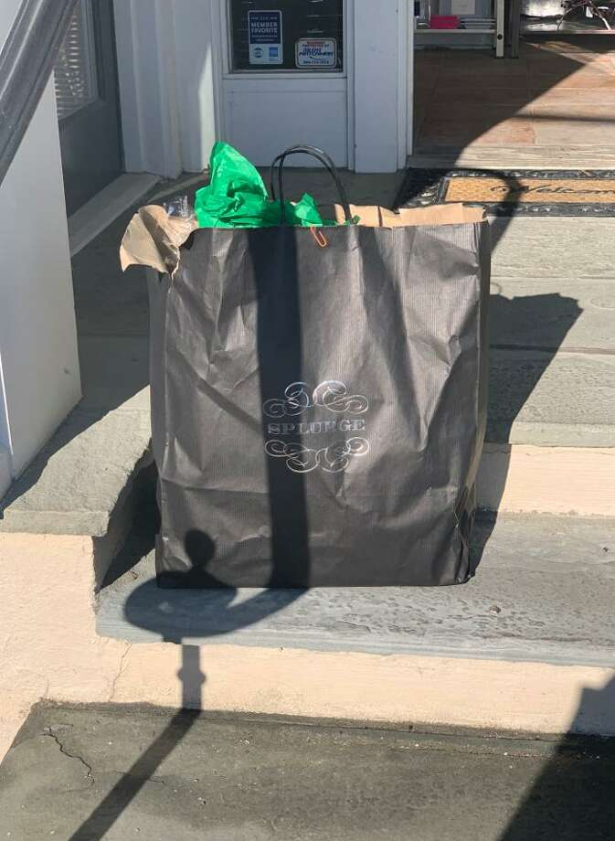 Darien resident Joe Calve unexpectedly found this long-lost bag of gifts when he visited gift store Splurge on Dec. 25, 2019, at 39 Lewis St., in Greenwich, Conn. Photo: Contributed Photo
