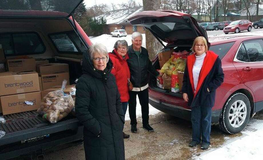 St. Bernard Catholic Church of Irons recently adopted 12 families at Lighthouse Pregnancy Center and filled food boxes for them. (Courtesy photo)