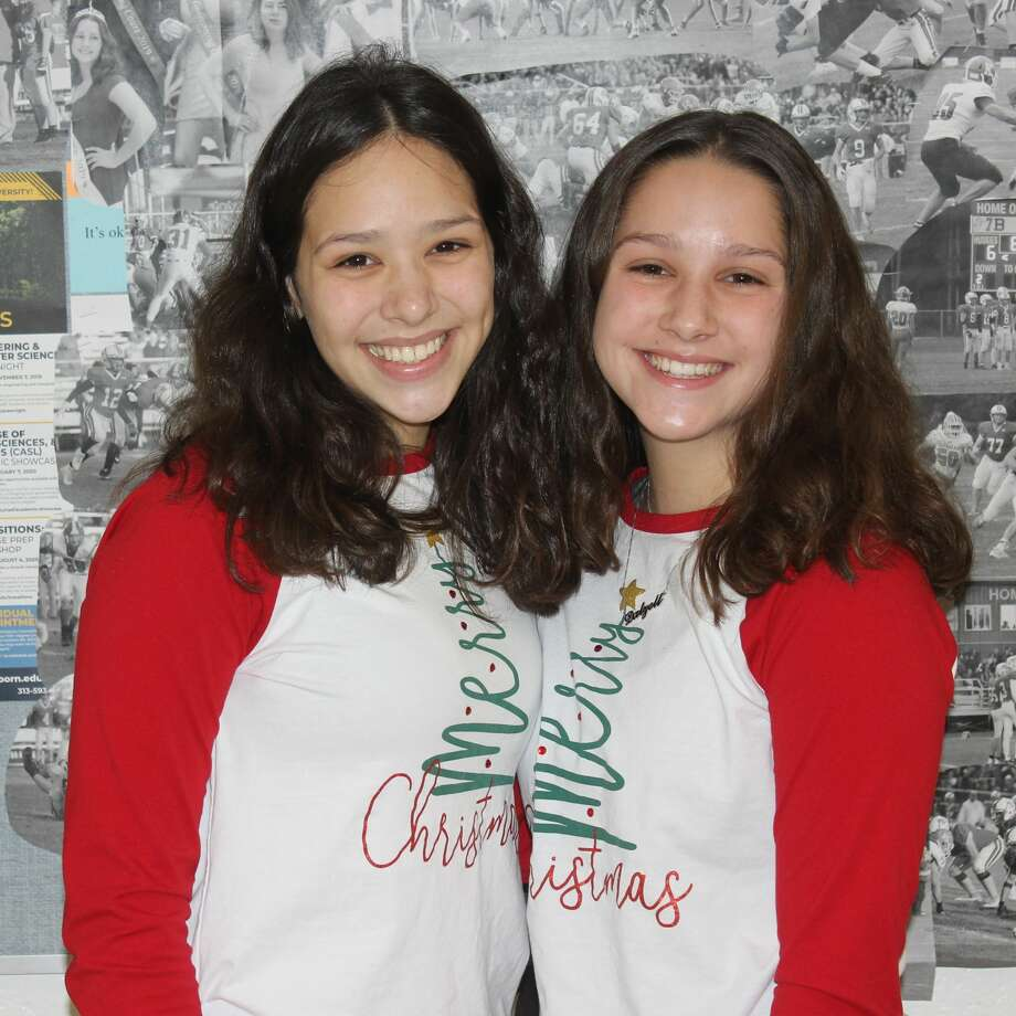 Sisters Triniti Dalzell (left) and Novia Dalzell (right) celebrate with matching Christmas outfits. Photo: Robert Myers