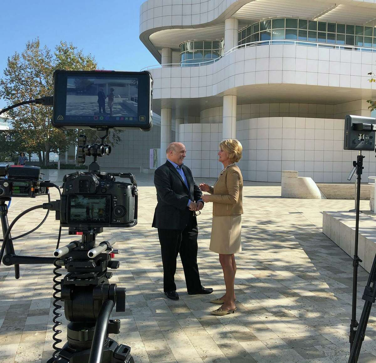 Leslie Mueller poses meets John Giurini, assistant director of public affairs at the J. Paul Getty Museum in Los Angeles.