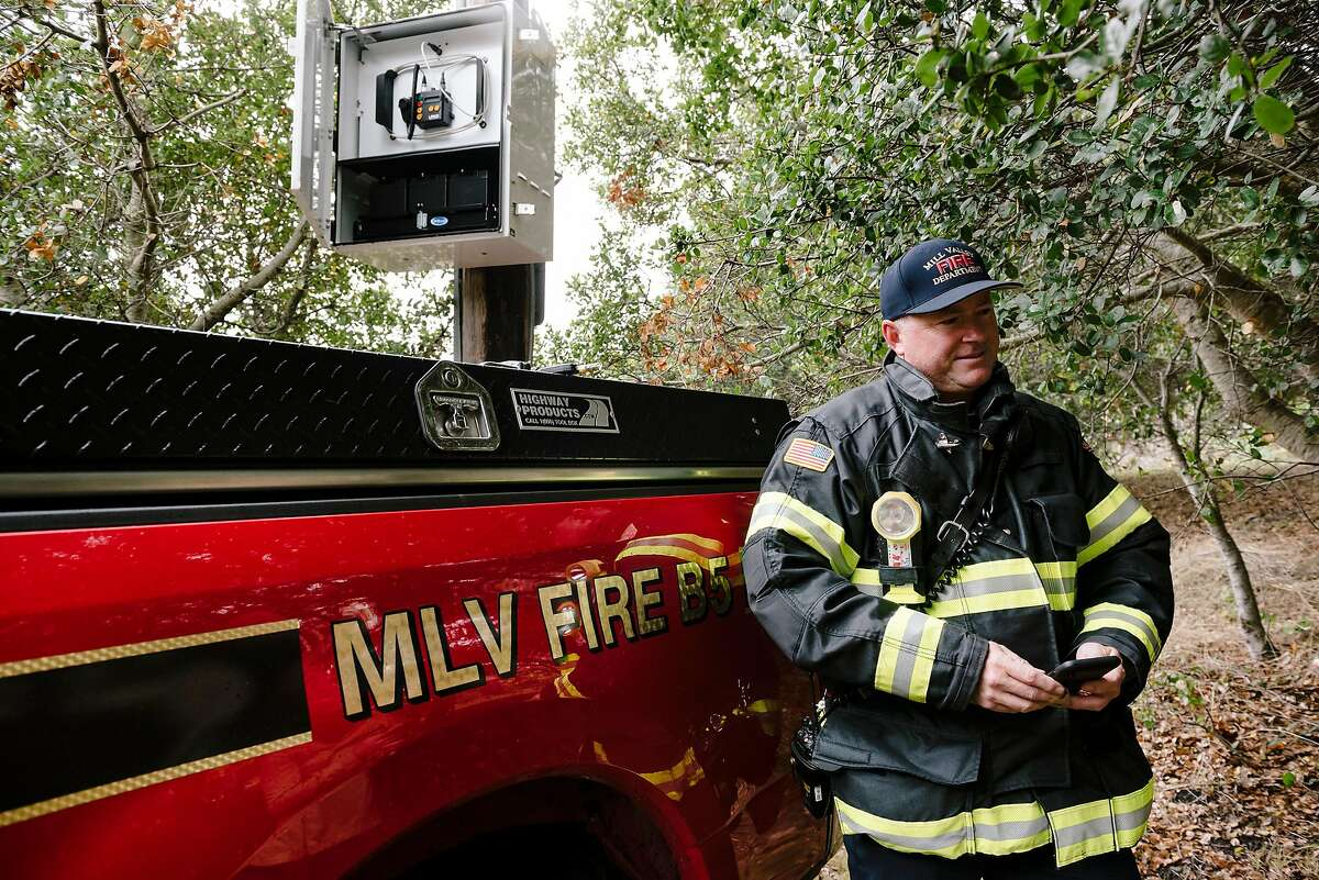 Mill Valley Fire Department Battalion Chief Scott Barnes, uses the an app to control one of Mill Valley's five new LRAD satellite-based siren notification emergency systems in Mill Valley, California, Saturday, December 7th, 2019.