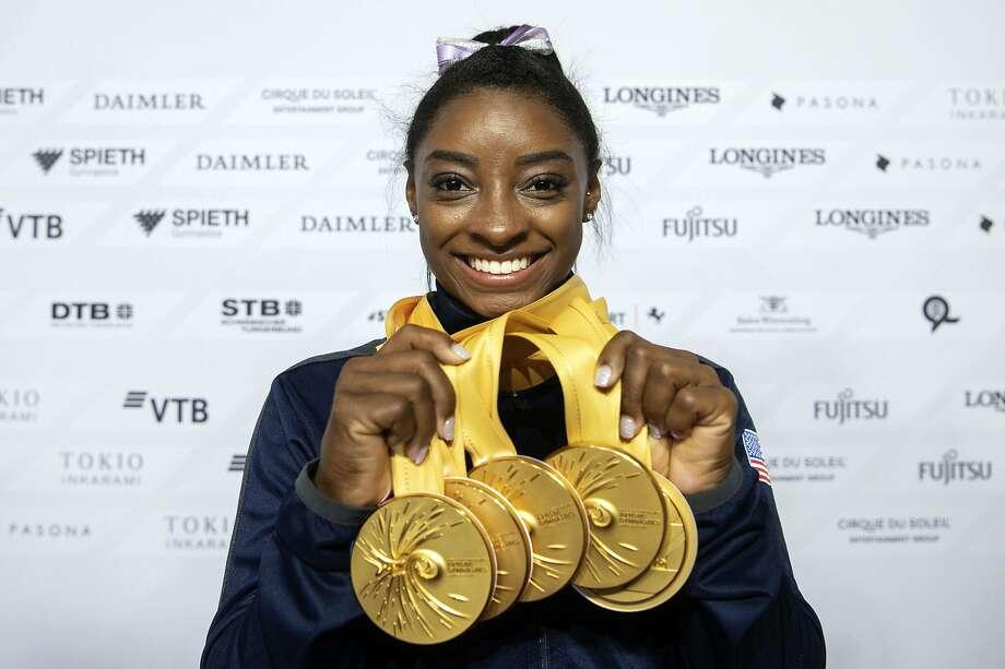 Simone Biles seems to soar through her sport (gymnastics) and her life. Photo: Marijan Murat / Associated Press