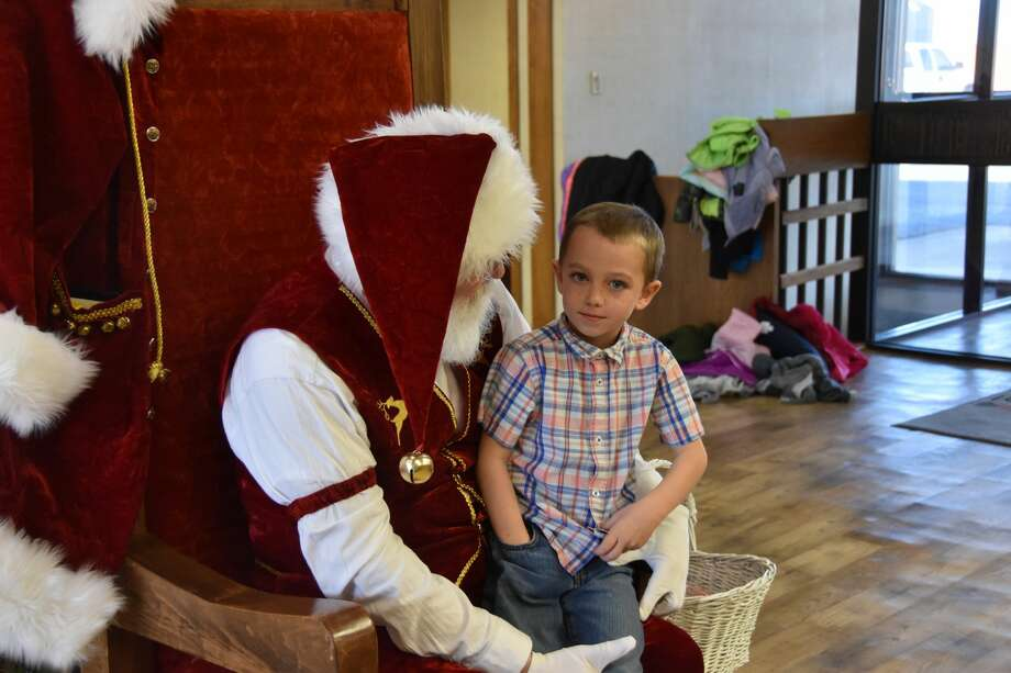 Kindergartners from Hart Elementary, including Kaden Nalley and Renata Cerecero, got a chance to chat with Santa last week during Centennial Bank's Open House. Photo: Neoma Williams/For The Herald