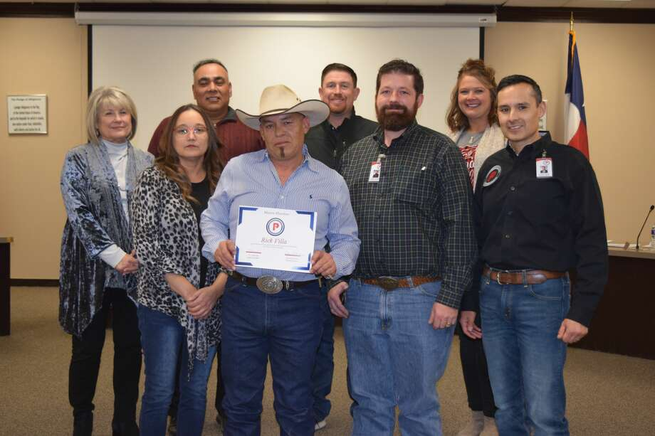 The Plainview ISD School Board presented local plumber Rick Villa with a special gift in recognition of his hard work to attaining certification as a master plumber. Villa has been a regular working with the district since October 2018. Pictured: (front row, L-R) Board member Sofia Rivera; Rick Villa, local plumber; Charles Mooney, facility supervisor for the district; Superintendent H.T. Sanchez; (back row, L-R) Board members Cheryl Dickerson, board secretary; Adam Soto, vice president; Tyler James; Amber Bass Photo: Ellysa Harris/Plainview Herald