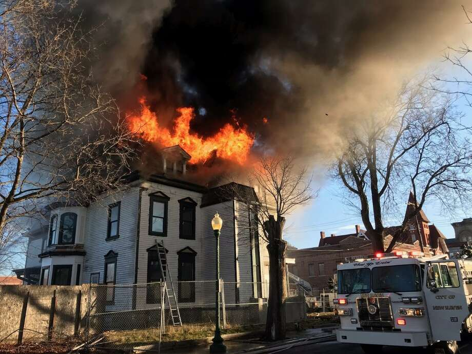 A building at 1303 Chapel St. goes up in flames on Wednesday, Christmas morning. Photo: Contributed Photo