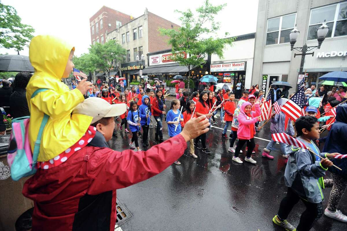 The Hart/Springdale band receives a huge applause and many waves from family and friends while walking down Bedford St. during the annual Memorial Day parade in downtown Stamford, Conn. on Sunday, May 27, 2018.