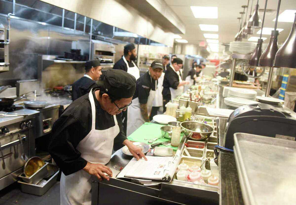 The newly opened kitchen of Pinstripes is shown in December in South Norwalk, Conn.
