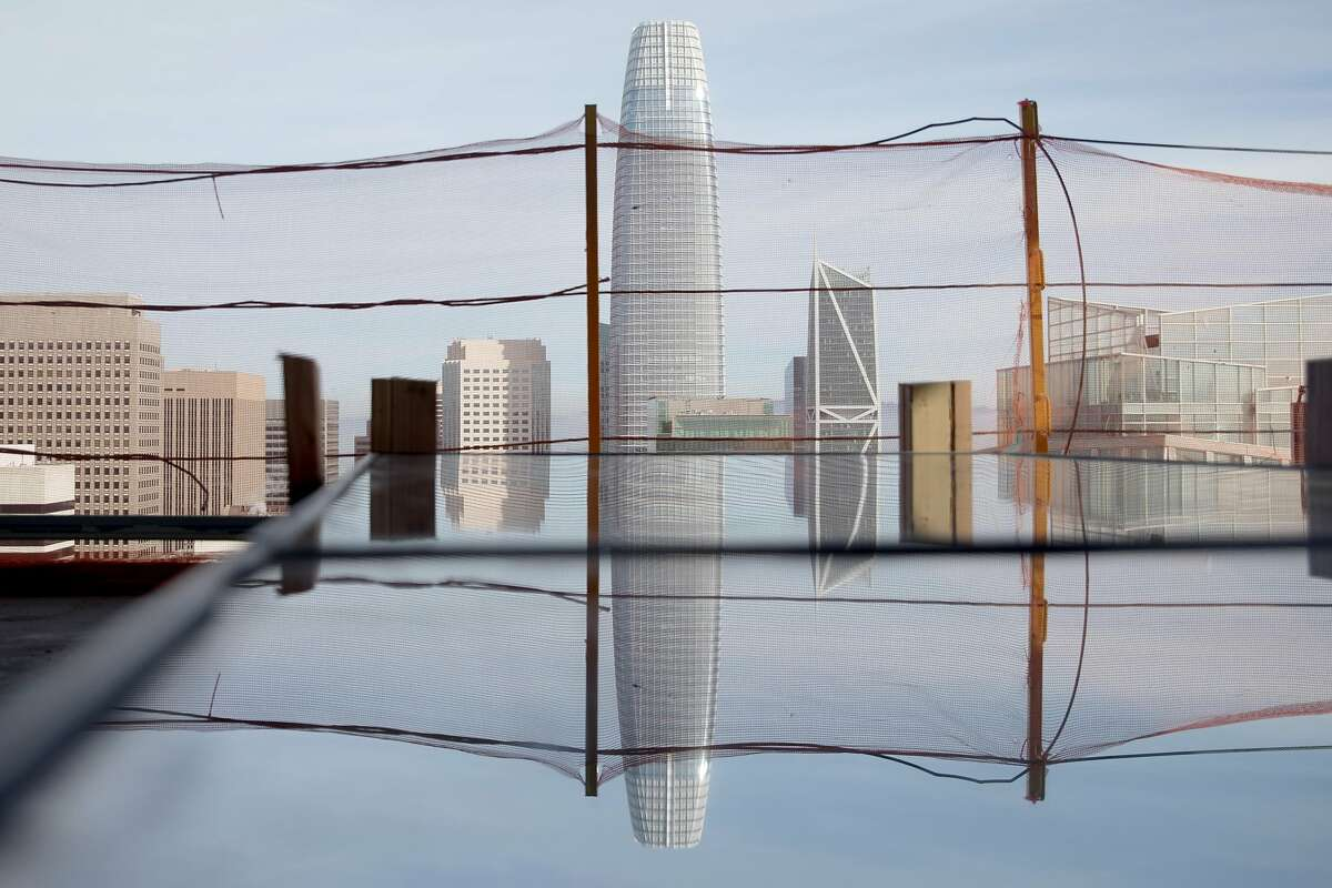 The San Francisco skyline is seen reflected in a window panel on the 40th floor of the Four Seasons Private Residence 706 Mission currently under construction in San Francisco, Calif. Friday, December 20, 2019.