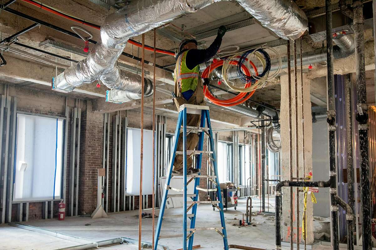 Restoration work continues on the historic Aronson Building during construction of the Four Seasons Private Residence 706 Mission in San Francisco, Calif. Friday, December 20, 2019.