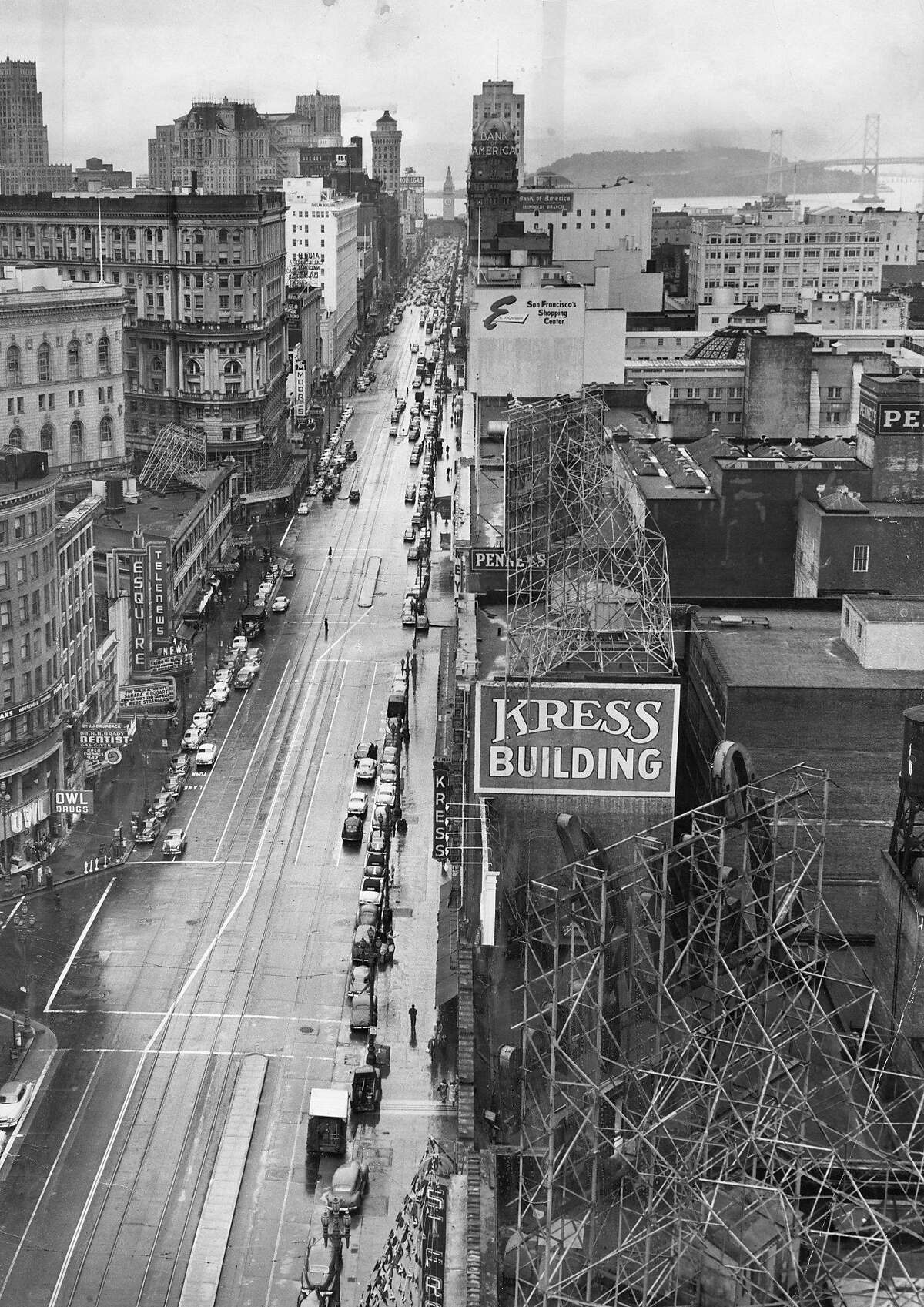 Market Street looking east, with the Ferry Building and Bay Bridge in the backgroundThis 24 x 18 inch print was found with diagonal crop marks, showing the central third of the photo. This is how it looks after I cleaned off the crop marks. Photo ran February 21, 1952