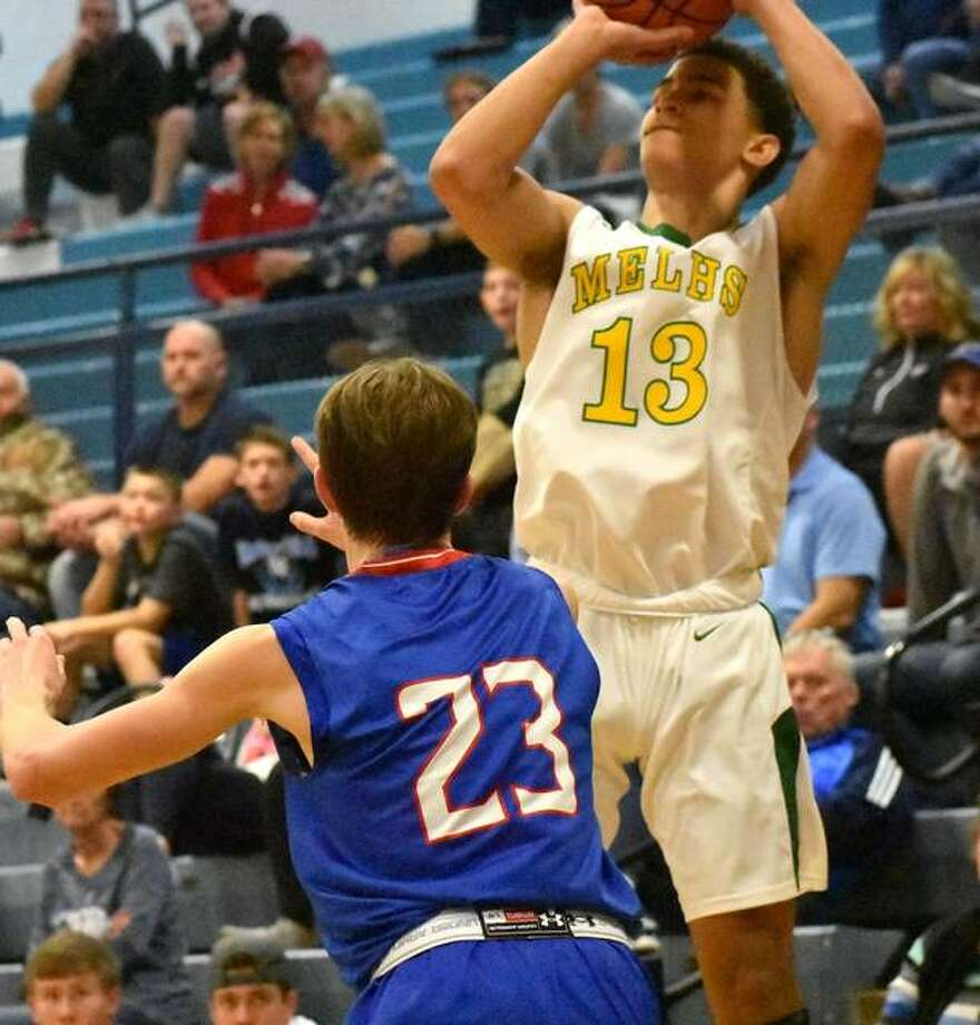 Metro-East Lutheran's AJ Smith puts up a 3-point shot over a Nashville defender in the second quarter on Thursday in Breese. Photo: Matt Kamp|The Intelligencer