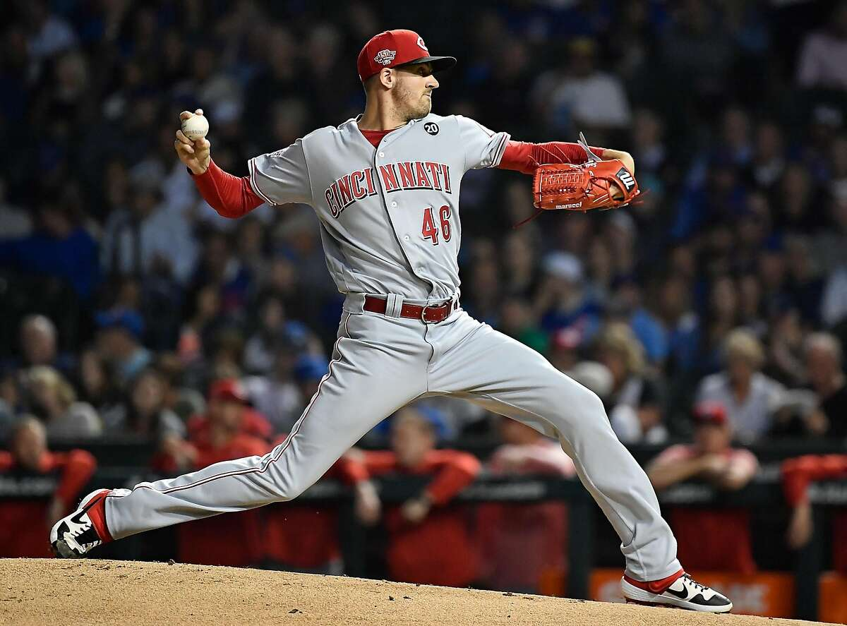 CHICAGO, ILLINOIS - SEPTEMBER 16: Starting pitcher Kevin Gausman #46 of the Cincinnati Reds delivers the ball in the first inning against the Chicago Cubs at Wrigley Field on September 16, 2019 in Chicago, Illinois. ~~
