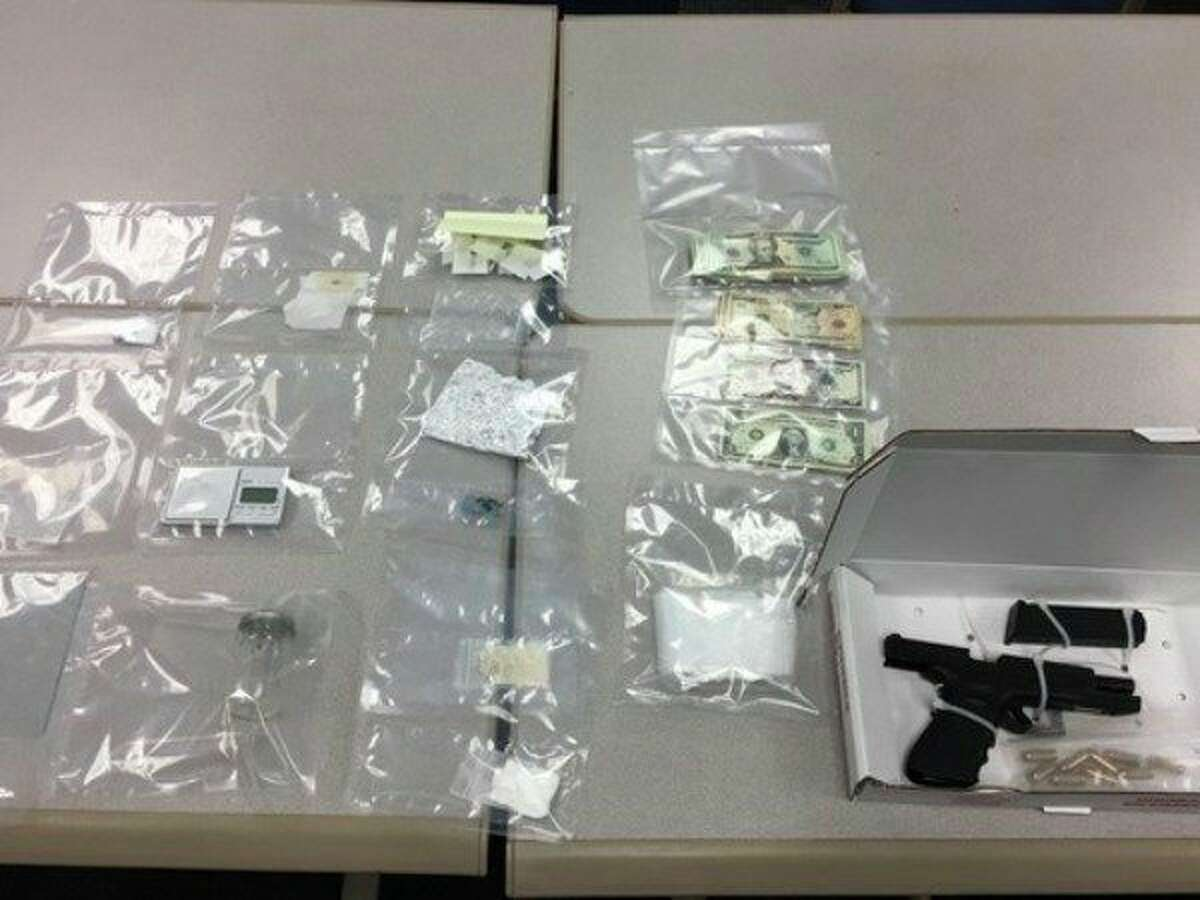 Money, drugs and a firearm were seized by Michigan State Police troopers following a traffic stop Dec. 23. (MSP/Courtesy Photo)