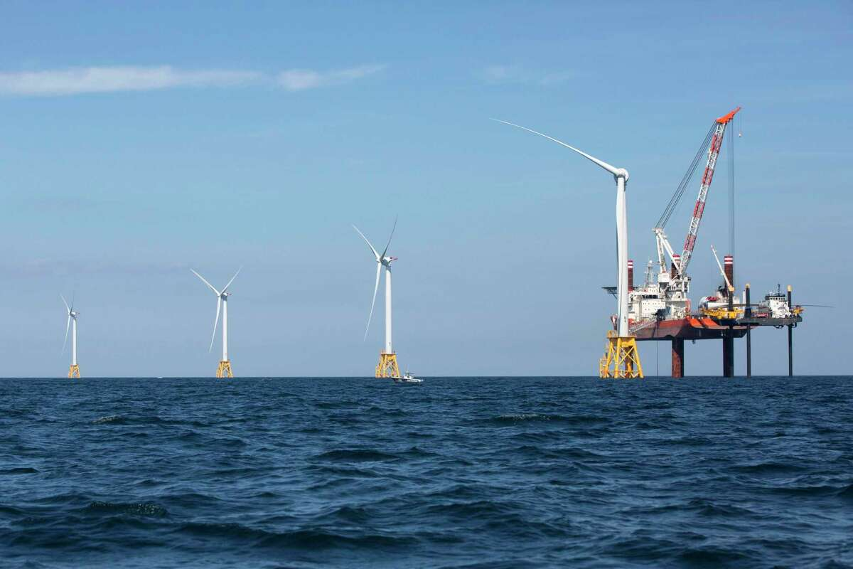 Wind turbines from the Deepwater Wind project are installed off Block Island, R.I., Monday, Aug. 15, 2016. Deepwater Wind's $300 million five-turbine wind farm off Block Island is expected to be operational this fall. (AP Photo/Michael Dwyer)