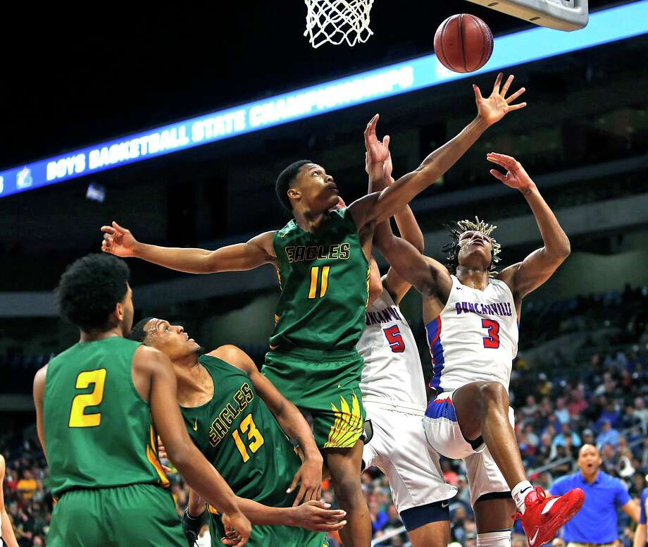 Klein Forest's Daylan Hamilton (11) battles for a rebound with Duncanville's Jahmi'us Ramsey. UIL boys basketball 6A state sinal between Klein Forest and Duncanville, March 9, 2019 at the Alamodome in San Antonio, Texas. Photo: Ronald Cortes/Contributor / Ron Cortes / 2019 Ronald Cortes