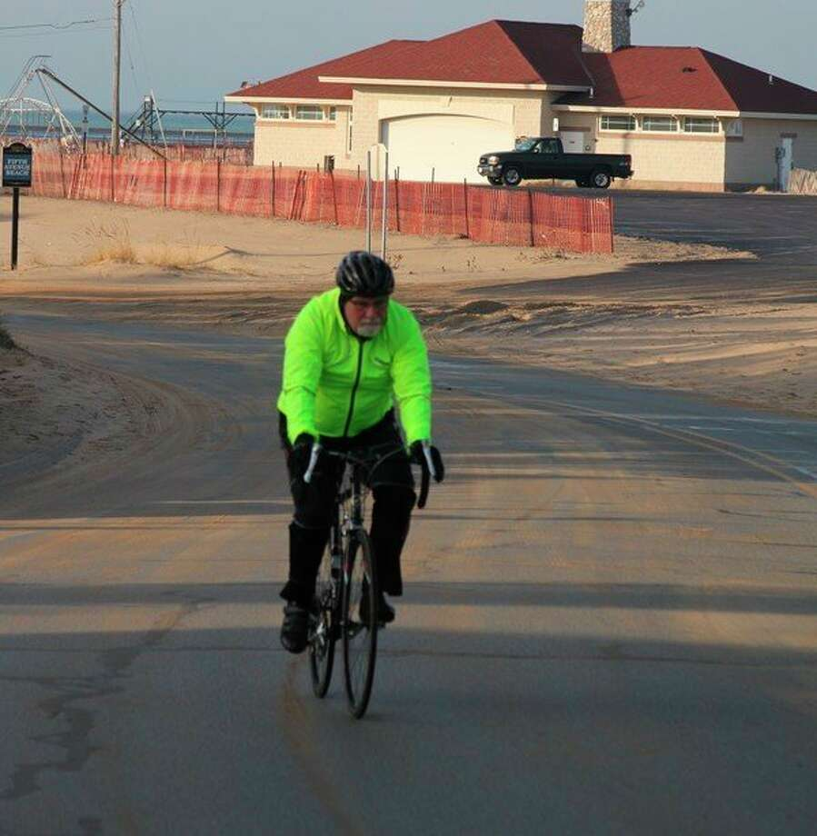 This bicyclist laughed and said he was taking advantage of the good weather on Thursday to work off all the food he ate over Christmas. (Ken Grabowski/News Advocate)