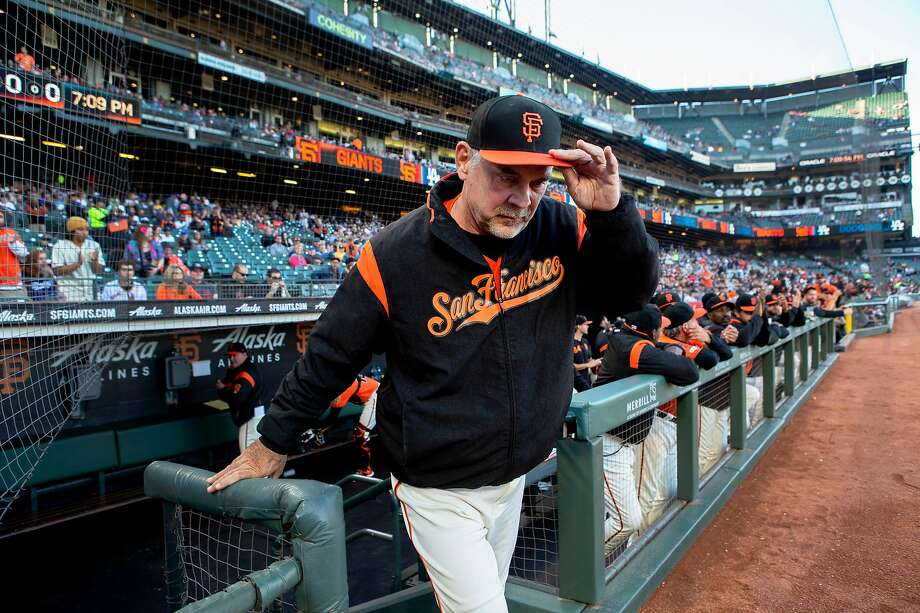 Giants manager Bruce Bochy tips his hat as he's honored for his 1,000th win before a game against the Los Angeles Dodgers in June in San Francisco. Photo: Santiago Mejia / The Chronicle