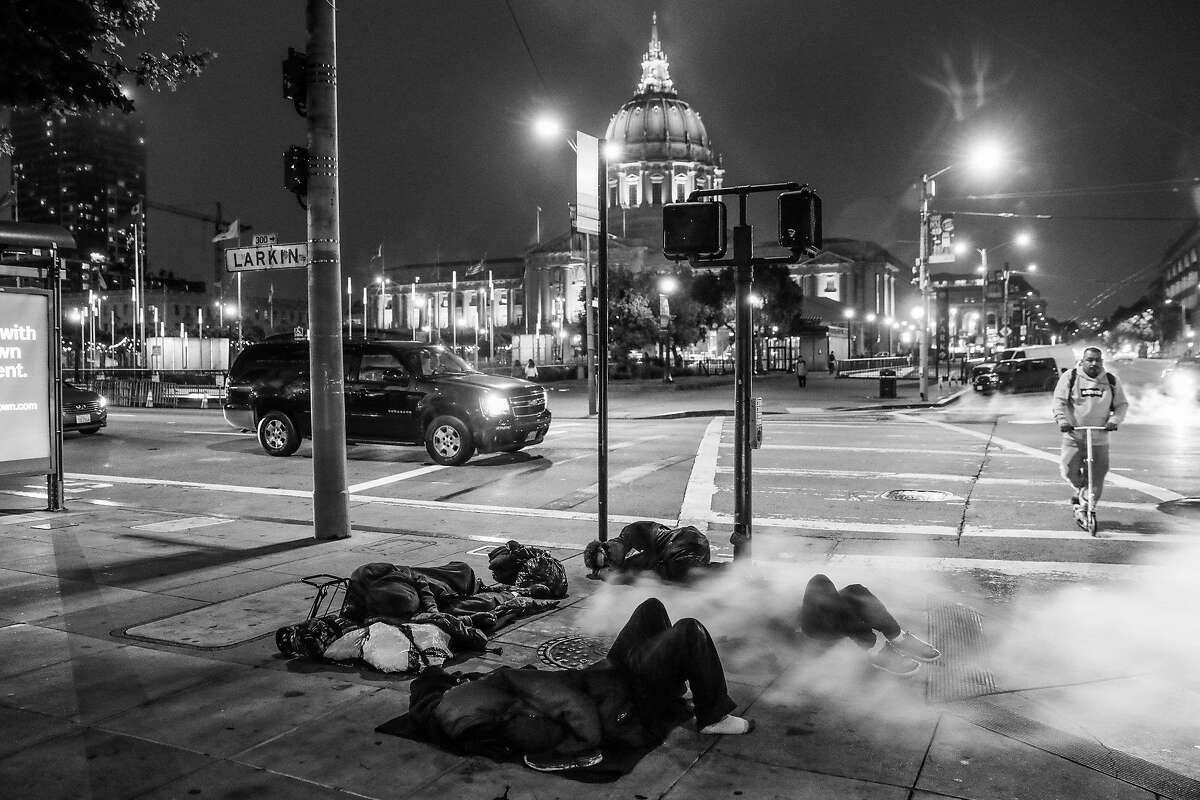 10:49 pm: Four homeless men including Larry Gaspar, 66 (right, tan sneakers) sleep on Larkin Street in San Francisco, California, on Tuesday, June 18, 2019. Photo taken on the corner of Larkin Street and McAllister Street at 10:49pm.