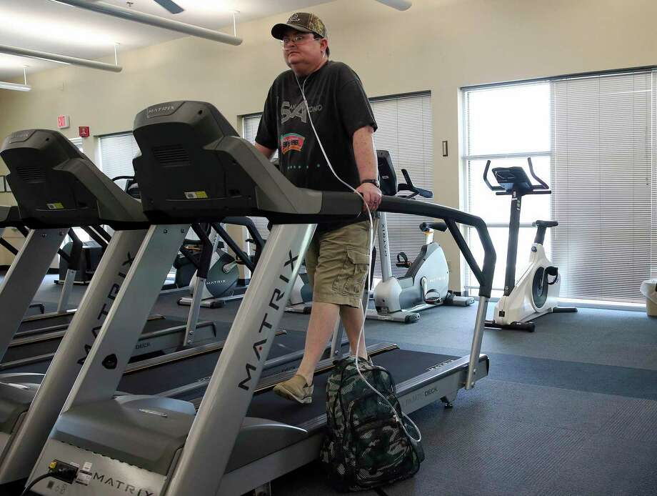 Schertz resident Amy Blair walks on a treadmill as she attends therapy at Christus Santa Rosa Rehab Services in New Braunfels on Friday, July 19, 2019. Blair had a default judgment issued against her for unpaid credit card debt. Blair suffers from pulmonary illness and fighting a rejection of a lung transplant from 2014. She medically retired as a police officer. (Kin Man Hui/San Antonio Express-News) Photo: Kin Man Hui / Staff Photographer / ©2019 San Antonio Express-News