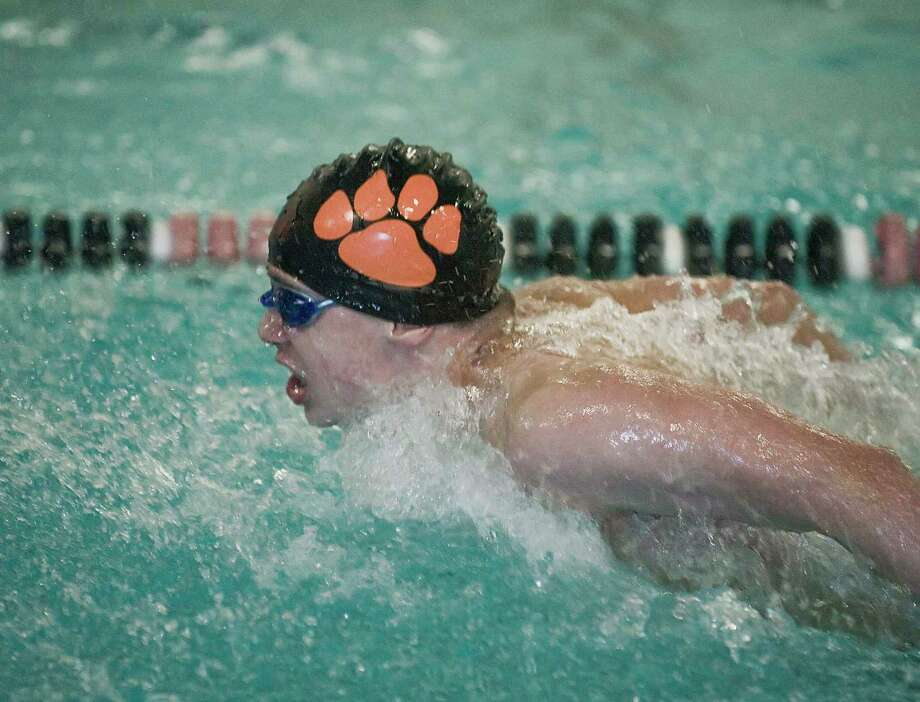 Kai O'Malley and the Ridgefield boys swim team ended the regular season with a 10-0 record. Photo: Scott Mullin / Hearst Connecticut Media / Scott Mullin ownership