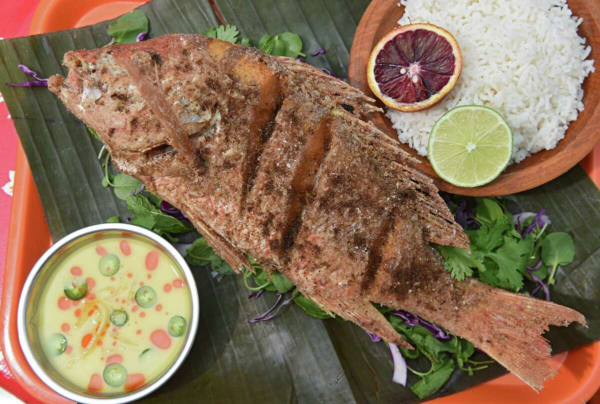 Whole fried fish served with green herbed salad, citrus-ginger vinaigrette and rice at Lil' Deb's Oasis on Thursday, March 30, 2017 in Hudson, N.Y. (Lori Van Buren / Times Union)