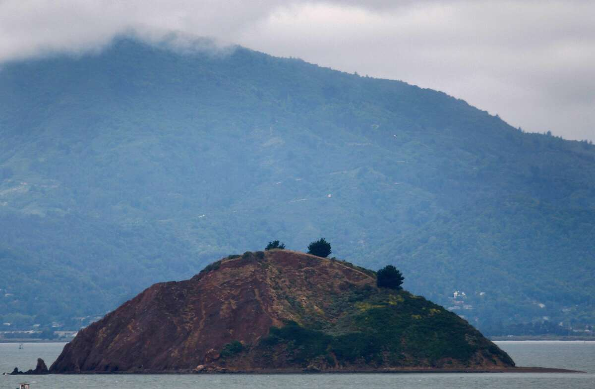 Red Rock Island is seen in front of Mount Tamalpais from Point Richmond, Calif., on Tuesday, June 9, 2009.