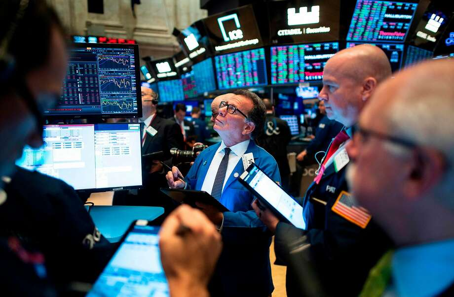 (FILES) In this file photo taken on November 14, 2019 traders work before the opening bell at the New York Stock Exchange (NYSE) on in New York City. - The tech-rich Nasdaq finished above 9,000 for the first time on December 26, 2019, powering to its 10th straight record on gains by Amazon and other tech giants. At the closing bell, the Nasdaq stood at 9,022.39, an increase of 0.8 percent over December 24th's close. (Photo by Johannes EISELE / AFP) (Photo by JOHANNES EISELE/AFP via Getty Images) Photo: Johannes Eisele, AFP Via Getty Images