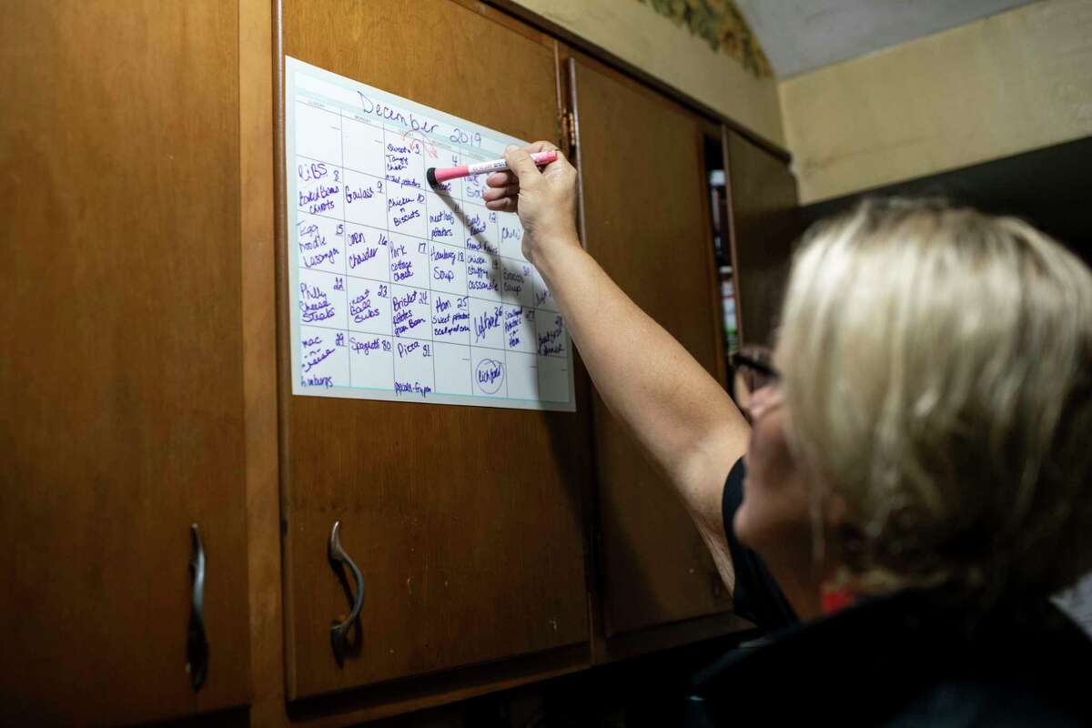 Anne Lee swaps around her planned recipes Dec. 4 because she was missing an ingredient while she plans her family's dinner for that night at the Lee family's dairy farm in Berkshire, N.Y.