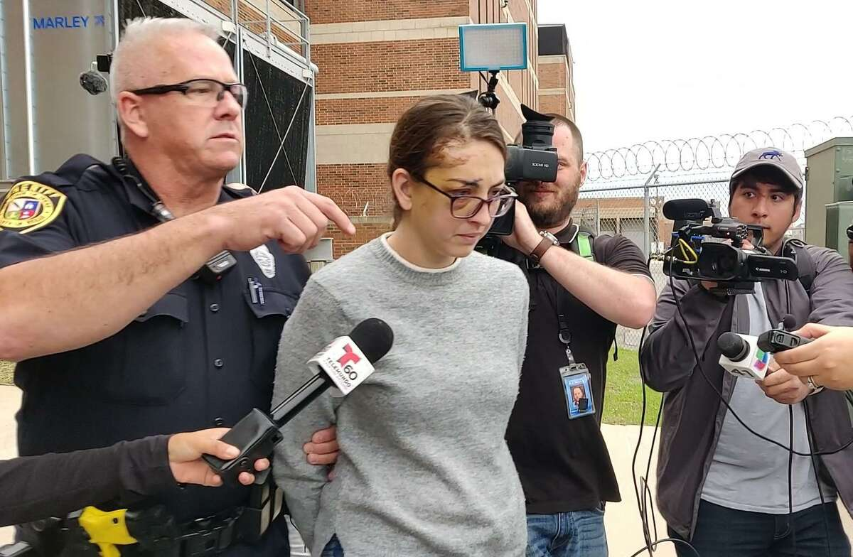 Natalie Susanne Saldana is escorted Thursday, Dec. 26, 2019, from the Bexar County Sheriff's Office after being arrested on a charge of intoxication manslaughter and two counts of aggravated assault with a deadly weapon after a man died from injuries he received in an accident Saldana was involved in.