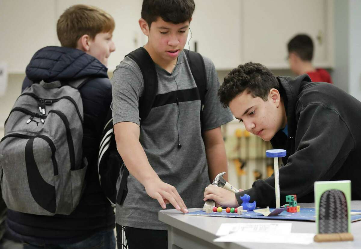 Ilian Villegas, right, and Abraham Guerrero, center, both 8th graders at The Advanced Learning Academy at Fox Tech High School, work on an engineering project.
