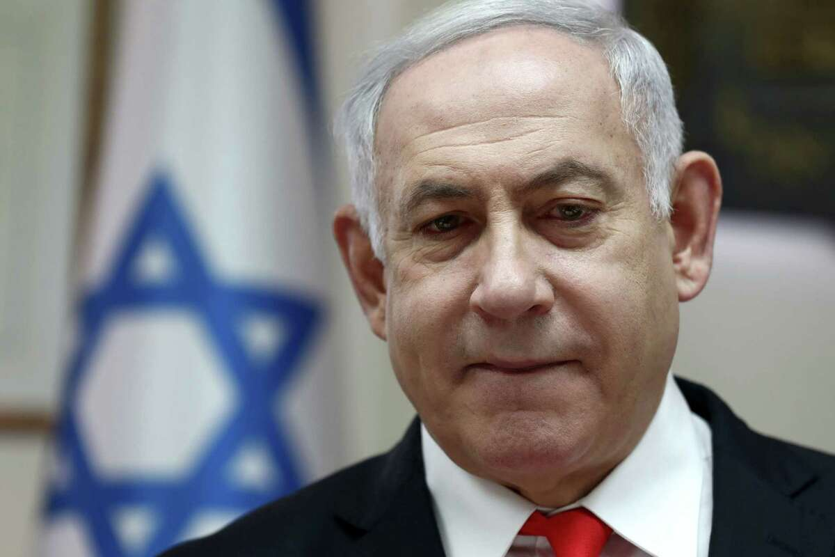 (FILES) In this file photo taken on December 15, 2019 Israeli Prime Minister Benjamin Netanyahu chairs the weekly cabinet meeting at his Jerusalem office. - Embattled Israeli Prime Minister Benjamin Netanyahu declared victory in a leadership primary in his right-wing Likud party on December 26, ensuring he will lead it into March elections. Initial results showed Netanyahu comfortably beating rival Gideon Saar, though a final tally was expected to take several hours. (Photo by GALI TIBBON / POOL / AFP) (Photo by GALI TIBBON/POOL/AFP via Getty Images)