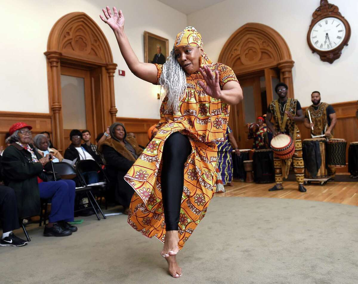 Sherry Caldwell of the group, Kendrick Baker and Mud Cloth, Drum & Dance, performs during the 16th Annual Kwanzaa Ceremony,