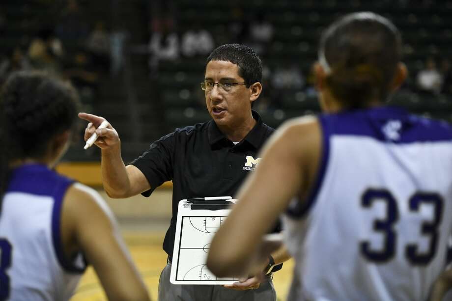 Midland High's head coach Wes Torres talks to his team during a time out Thursday, Dec. 26, 2019 at Chaparral Center. Photo: Jacy Lewis/Reporter-Telegram