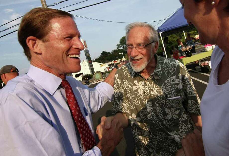 Democratic candidate for US Senate and Connecticut Attorney General Richard Blumenthal, at left, greets Stanley Brandes, of Berkley, CA while he visited the Woodmont Farmer's Market at Robert Treat Farm in Milford, Conn. on Wednesday August 11, 2010. Brandes' son Jared Katz lives in Milford. Photo: Christian Abraham / Connecticut Post