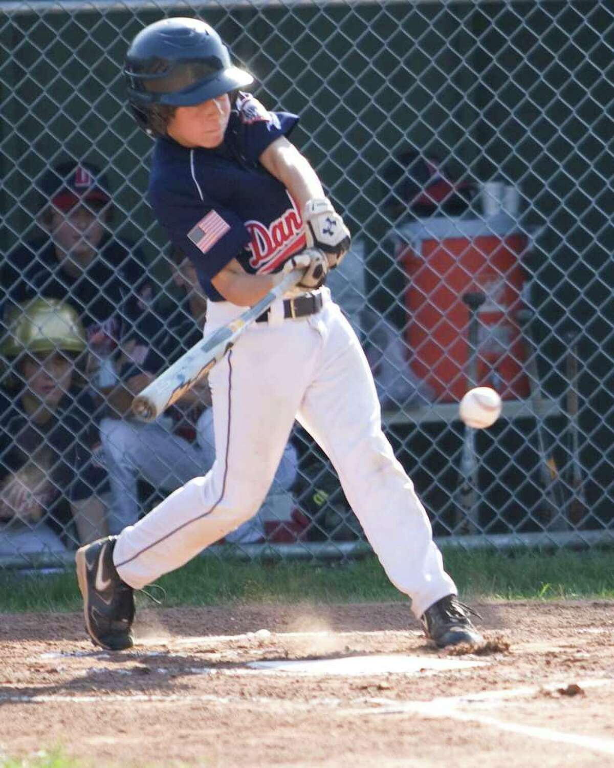 Danbury's Brent Jacobellis strokes a single to right against Exeter, N.H., during Cal Ripken 11-year-old New England Regional Tournament play Wednesday in New Milford.